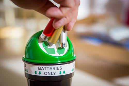 Batteries being placed into a battery bank for recycling
