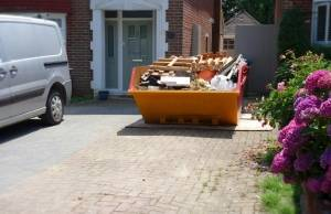 Loaded Skip On Driveway